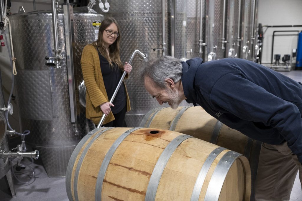 Denis and Marie check the mead barrels at Kinsale Mead